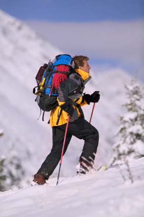backpacker on snowshoes